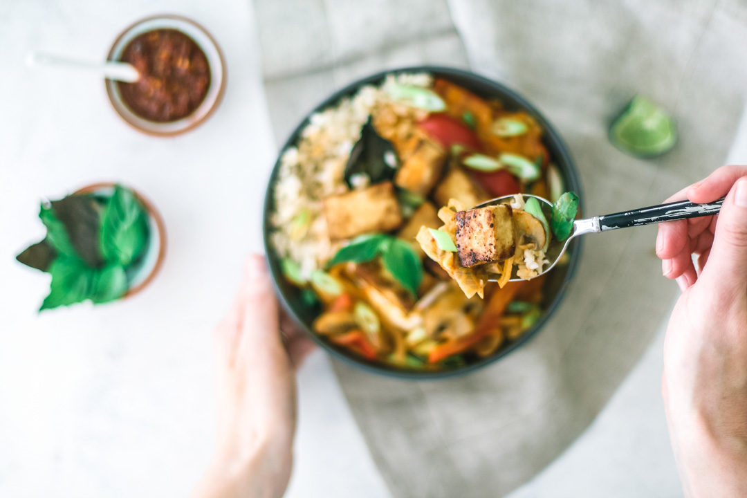 Easy Thai Red Curry With Tofu being eaten