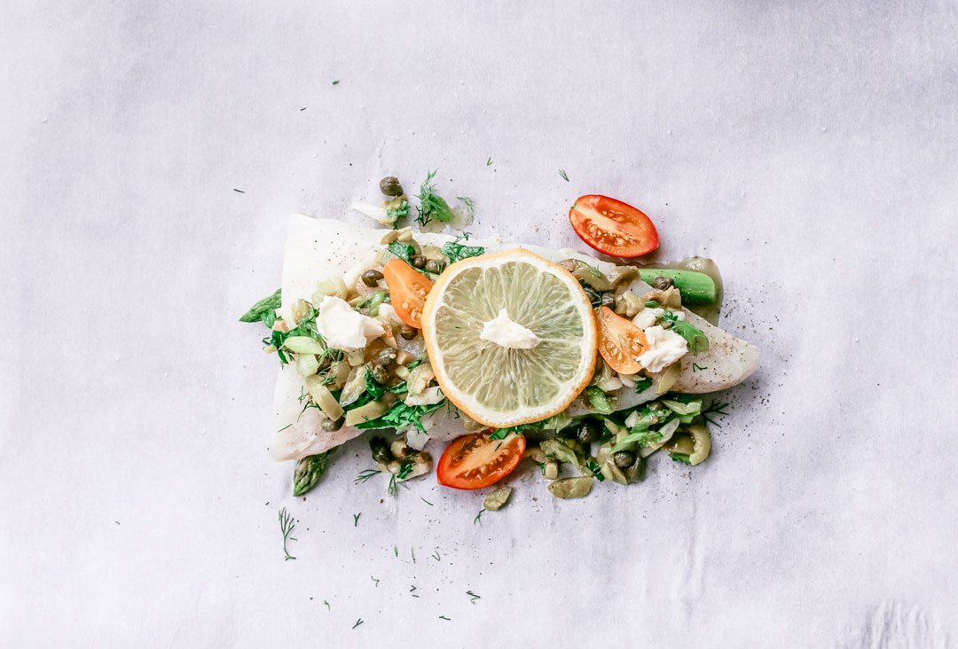 fish in parchment paper Want an easy and foolproof way to cook fish learn how to cook fish in parchment paper for super tender and flavorful fillets every time.