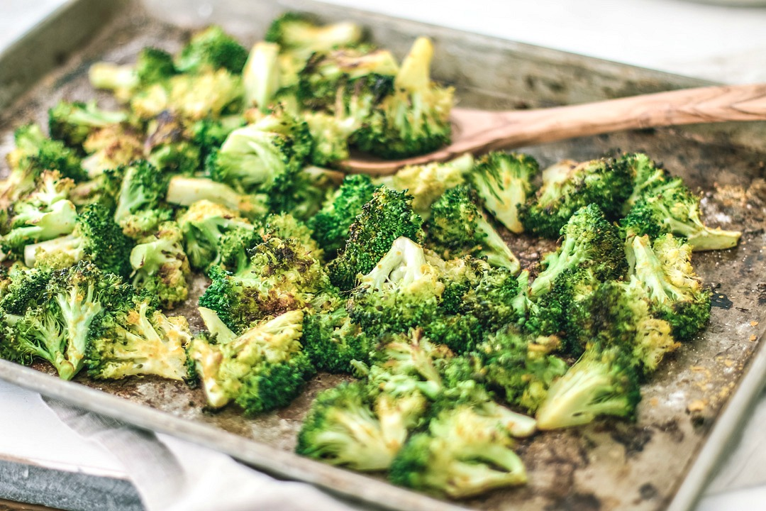 Broccoli spread out on a sheet pan