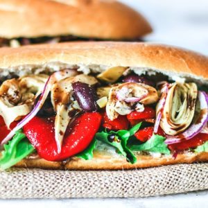 Close up of fresh buns stacked with fresh Italian ingredients.