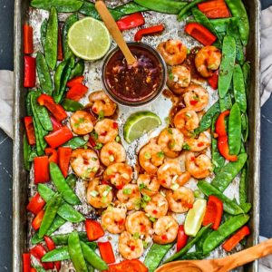 Sheet pan of Spicy Thai Sweet Chili Shrimp and vegetables.