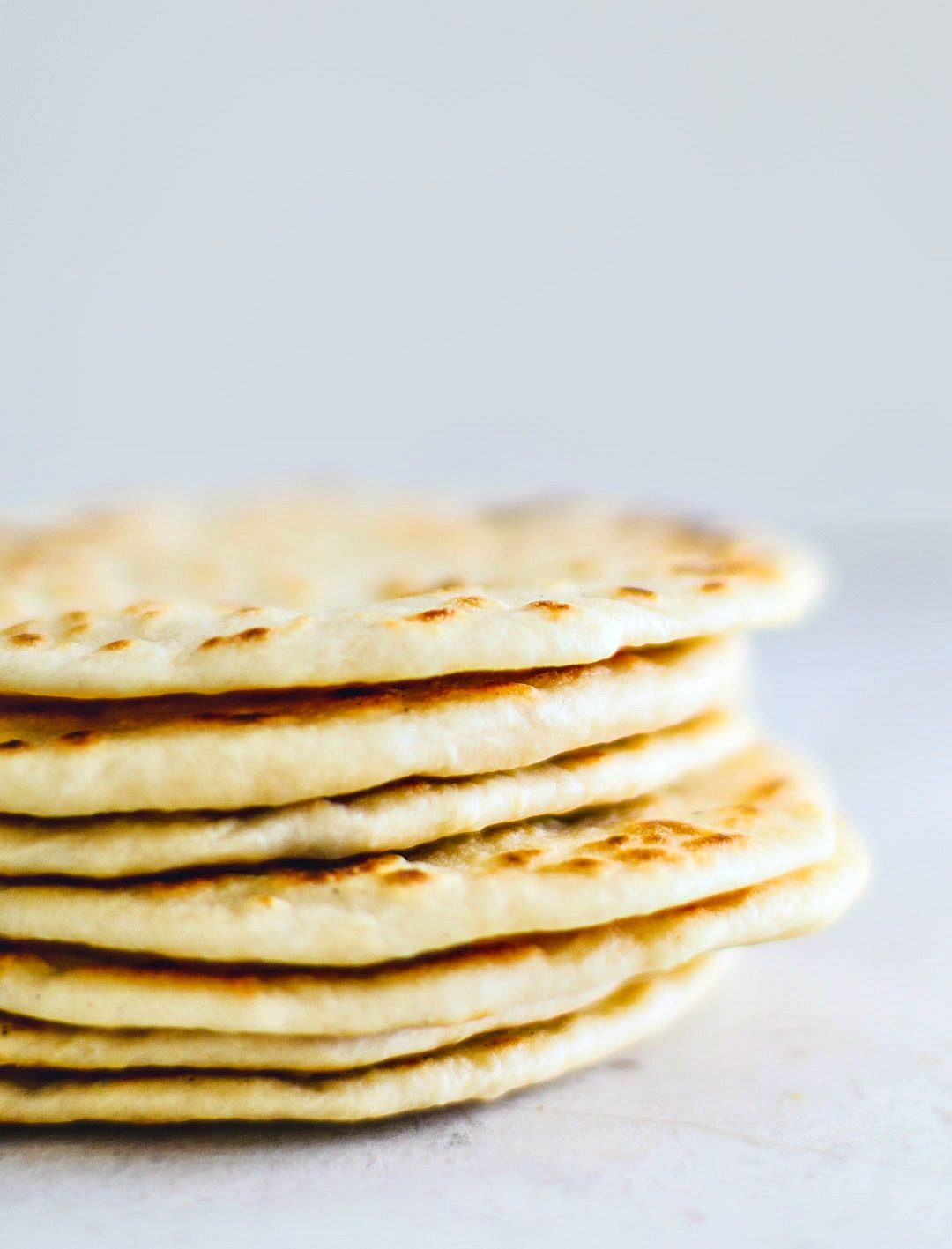 Stack of homemade flour tortillas.