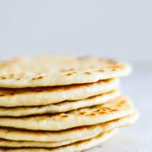Stack of homemade flour tortillas.