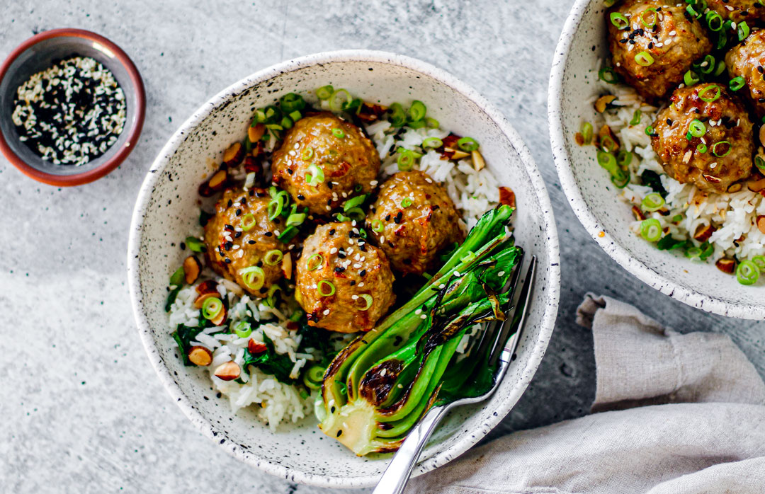 Bowl of turkey meatballs on rice.