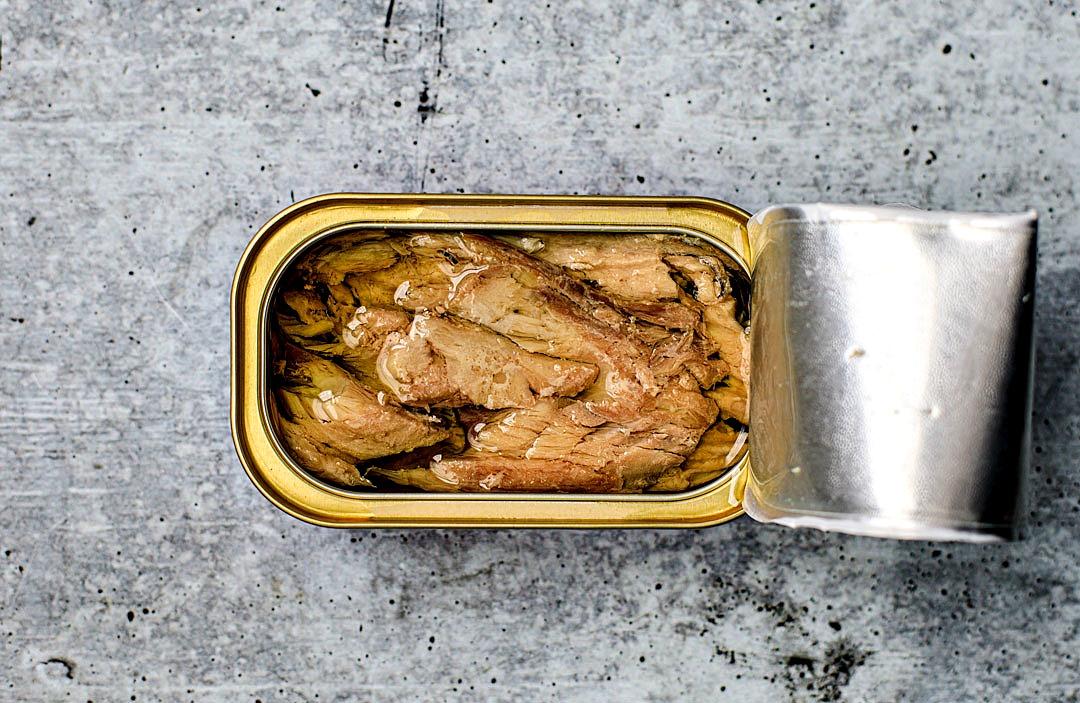 Opened tin of King Oscar Mackerel fillets in olive oil.