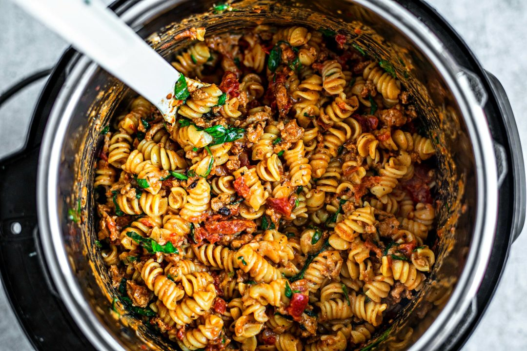 Instant Pot full of cooked creamy tomato pasta.