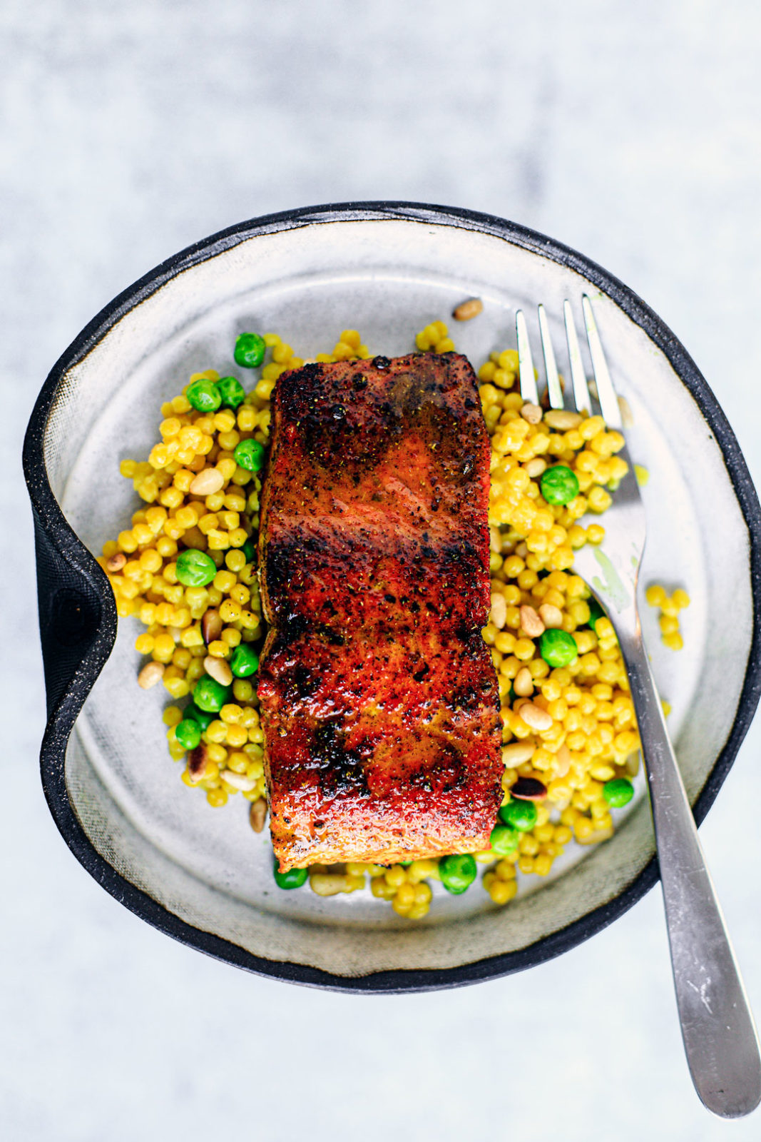 Pan-seared salmon over bed of couscous and peas.