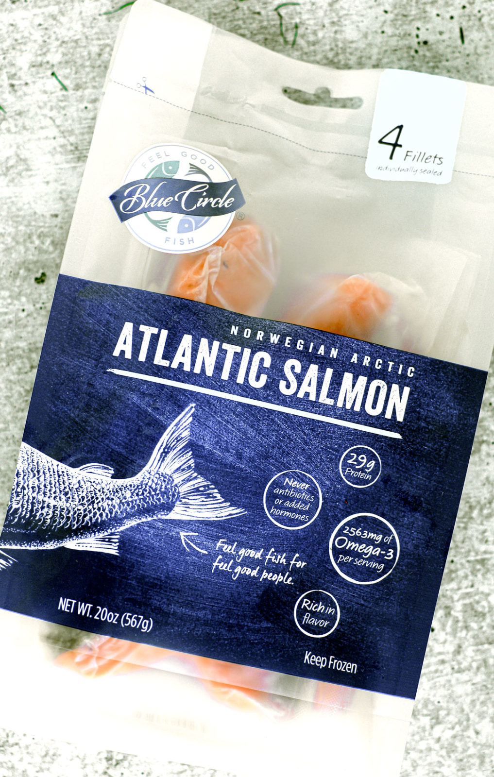 A sealed package of Blue Circle Foods Atlantic Salmon fillets.