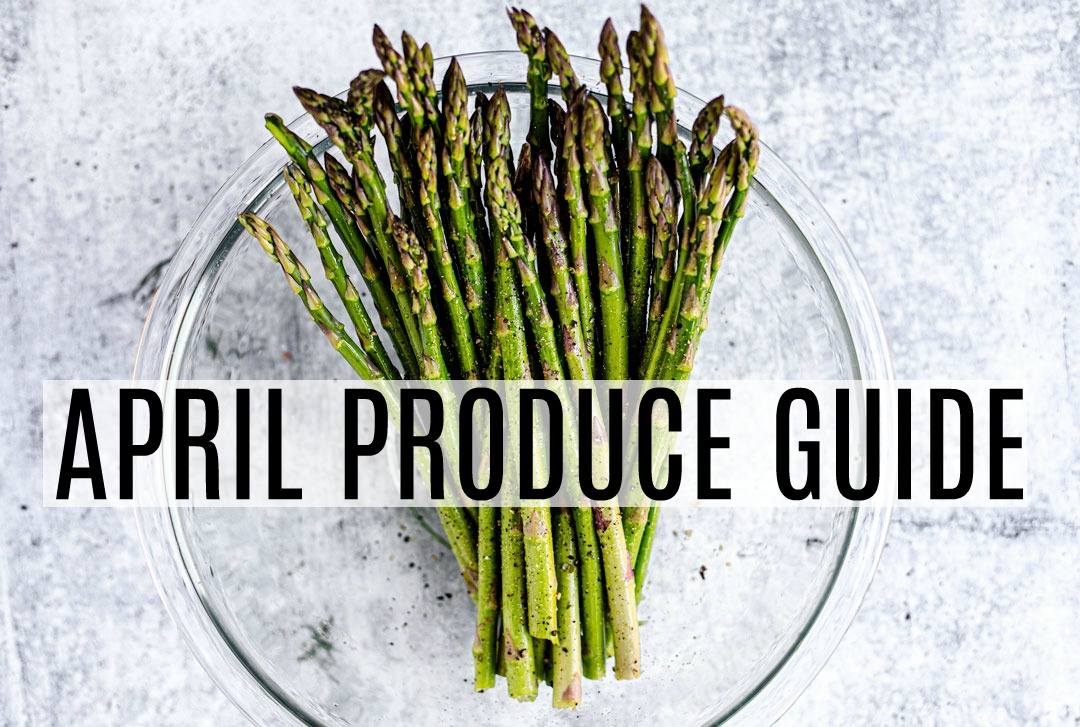Bowl of Asparagus with text April Produce Guide over top.