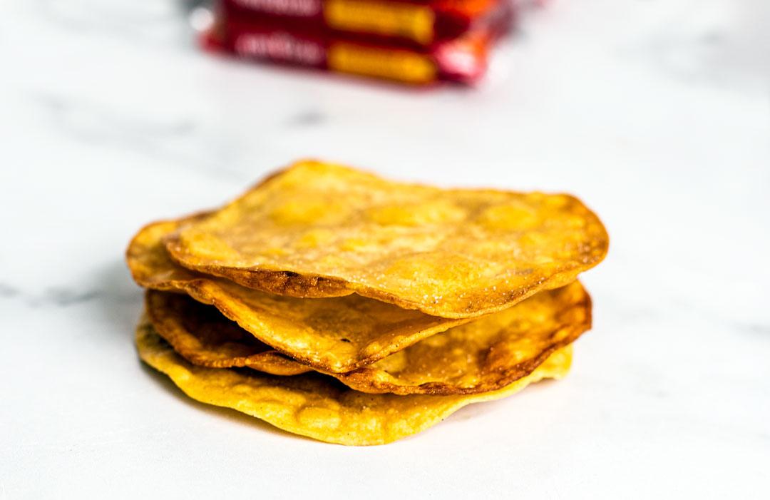 Close up of a stack of golden crisp tostadas.