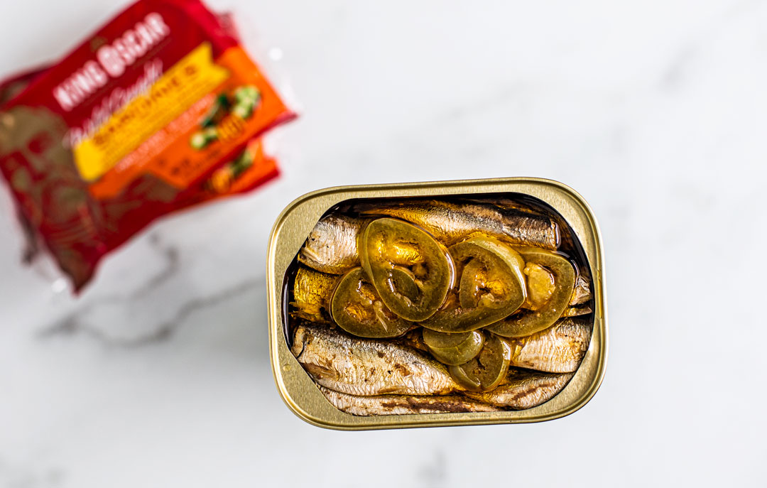 Close up of opened can of King Oscar Brisling Sardines with Hot Jalapeno Peppers.