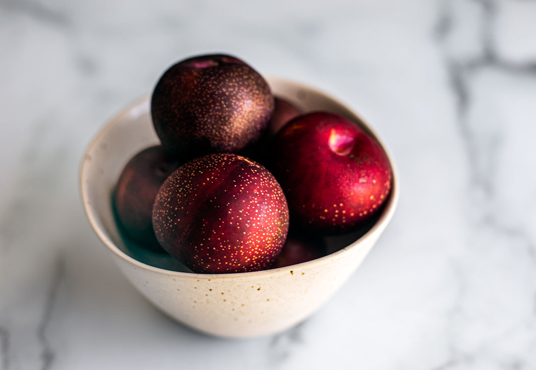 Bowl of plums.