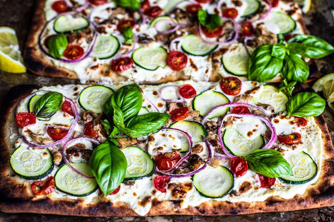 Close up of baked flatbread pizza.