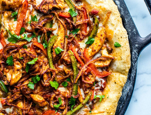 Chicken Fajita Pizza on a cast iron pizza pan.