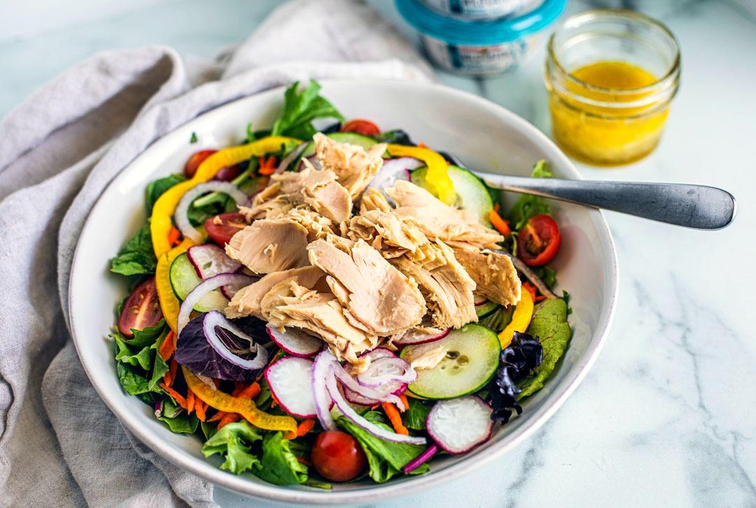 Side shot of Seasonal Garden Salad with Tuna.