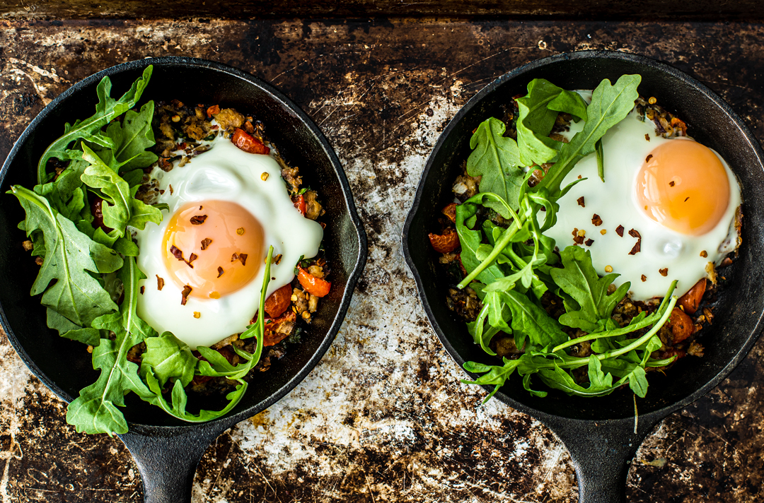 Close up of Fisherman's Eggs topped with fresh arugula.