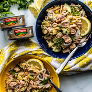 Bowls of quinoa salad topped with tuna.