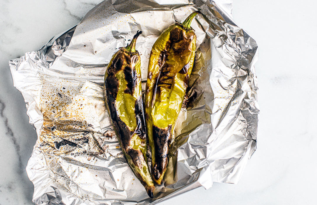 Roasted hatch chiles in foil.