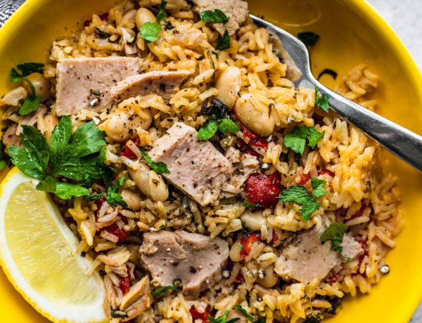 Bowl of Mediterranean Instant Pot Rice with Tuna in bright yellow bowl.