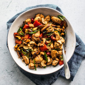 Serving bowl full of cashew chicken.