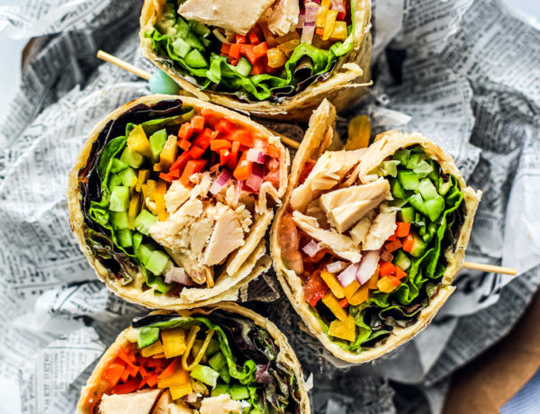 Overhead shot of colorful veggie-filled tuna wraps.