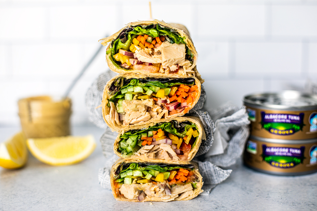 Side shot of tuna wraps stacked on top of one another.
