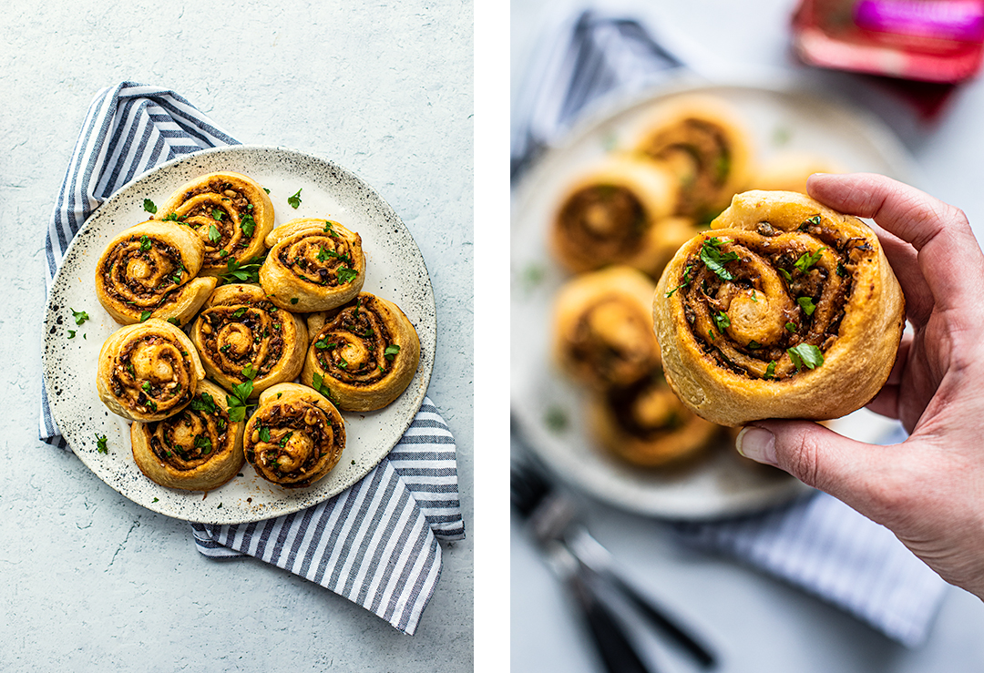 Left: Overhead shot of serving late full of Greek pinwheels; Right: overhead shot of hand holding a Greek pinwheel close up.