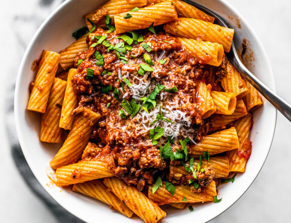 Overhead shot of bowl of rigatoni topped with turkey bolognese.