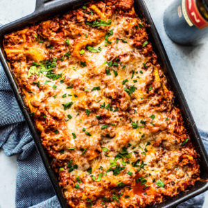 Overhead shot of baking dish full of cheesy lasagna.