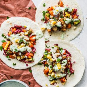 Fish tacos topped with mango salsa and jalapeño cream sauce.