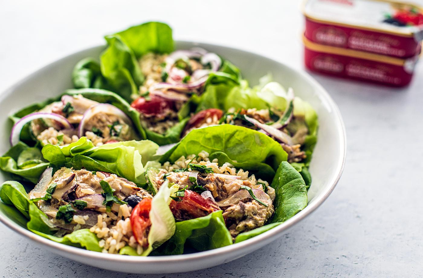 Side close up of serving bowl full of Mediterranean mackerel lettuce wraps.
